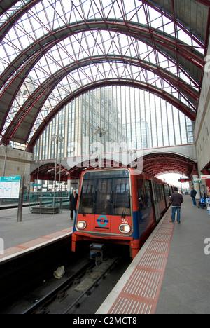 Docklands Light Railway Train at Canary Wharf station, London. - Stock Photo