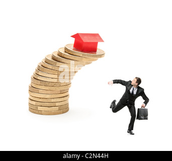 Scared investor running away from falling real estate prices - Stock Photo