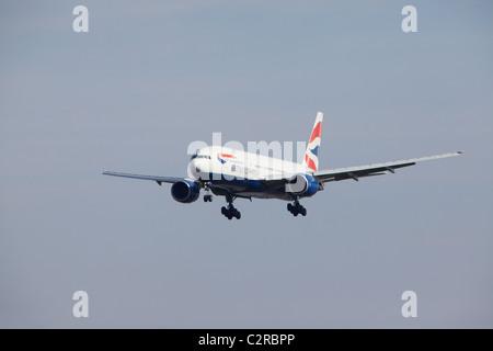 British Airways Boeing 777-268ER on final approach - Stock Photo