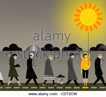 People under rain clouds, one holding sun-shaped balloon - Stock Photo