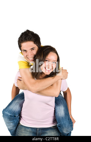 A young boy getting a piggyback ride from a teen girl and having fun together isolated on white background - Stock Photo