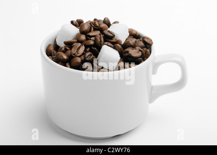 cup with coffee beans and sugar. closeup - Stock Photo
