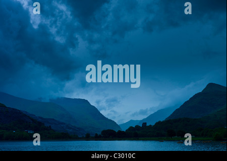 Llanberis Pass with Snowdonia on right, Dolbadarn Castle and Llyn Padarn lake, in Snowdonia National Park, Wales - Stock Photo