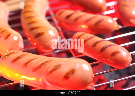 Hot sausages on barbecue - Stockfoto