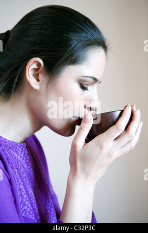 Women drinking herbal tea - Stock Photo