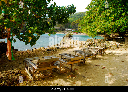 Chairs and hammock on the beach cove at Great Huts eco-resort, Boston Bay, Portland, Jamaica - Stock Photo