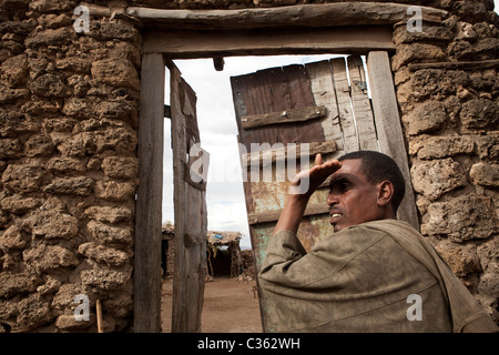 An Argoba man stands outside his house in the town of Koremi, near Harar, in the Ethiopian Highlands of Africa. - Stock Photo