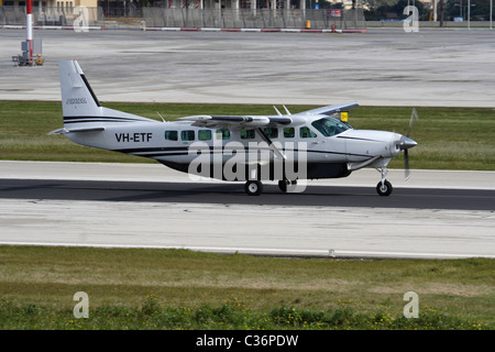 Cessna 208B Grand Caravan single-engined turboprop commuter aircraft taxiing for departure from Malta - Stock Photo
