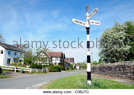 Weobley village, Herefordshire, England, UK. Road sign black & white striped in Weobley. - Stock Photo