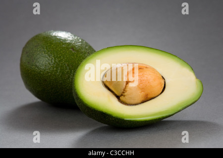Fresh Avocado - opened, with stone - Stock Photo