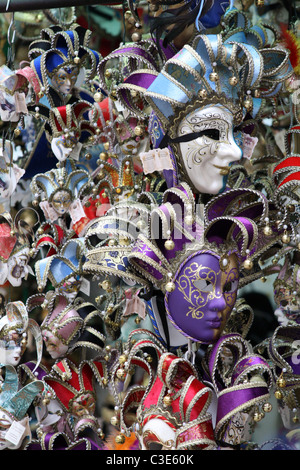 Collection of Venetian masks for sale in Venice, Italy - Stock Photo