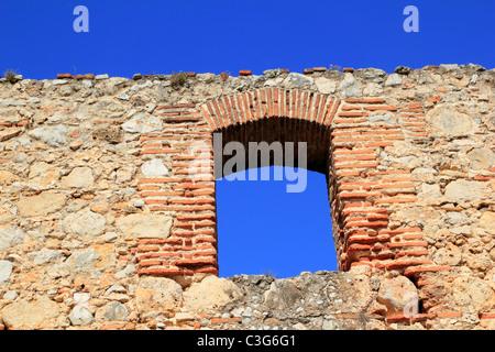 brick segmental arch in ancient masonry stone wall Spain - Stock Photo