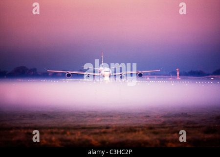 Airplane in the fog at London Heathrow Airport, UK - Stock Photo