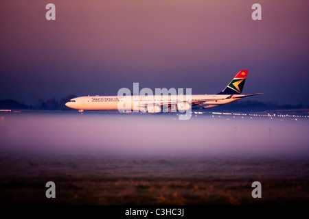 South African Airways Airbus A340-642 at London Heathrow Airport, UK - Stock Photo