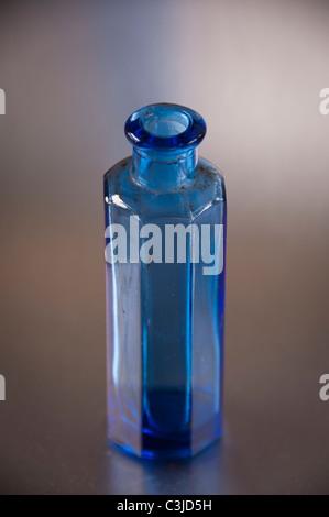 blue victorian poison bottle - Stock Photo
