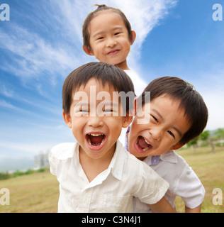 Portrait of happy kids outdoor - Stock Photo