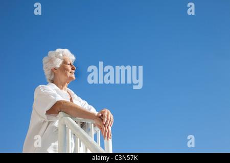 Senior Woman on the beach - Stock Photo