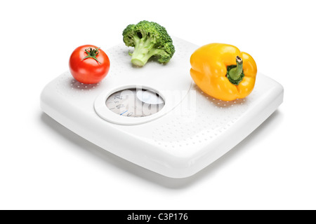 Vegetables on a weight scale - Stockfoto