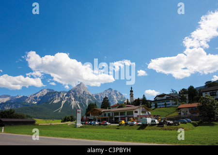 Austria, Tyrol, Lermoos, View of buildings with mountain in background - Stock Photo