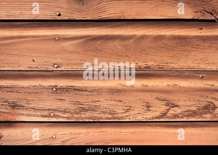 Some old and weathered wooden siding. - Stockfoto