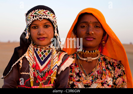 Young woman and little girl smiling in Sam desert, Jaisalmer, Rajasthan, India, Asia - Stock Photo