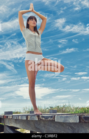 Woman doing Yoga Pose - Stock Photo