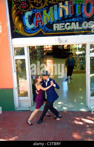 Argentine tango dancers in the La Boca barrio of Buenos Aires, Argentina. - Stock Photo