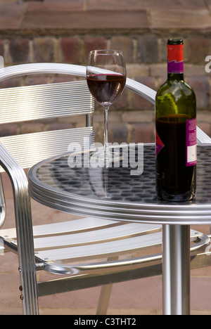 Bottle of wine on a terrace table at bonitas winery for 3 summerland terrace