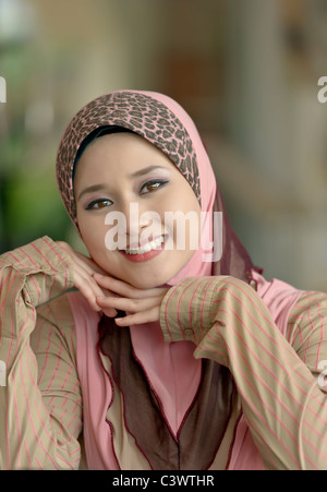 Close-up portrait of young beauty Asian Muslim woman in head scarf with lovely smiles - Stock Photo