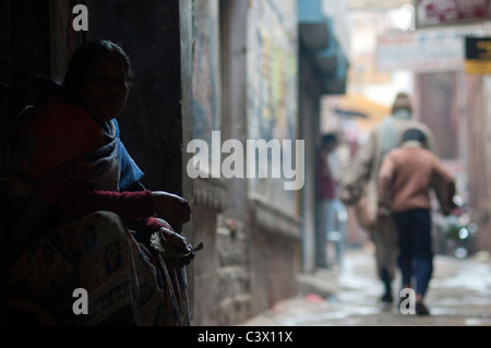 Woman in the alleys of Varanasi, - Stock Photo
