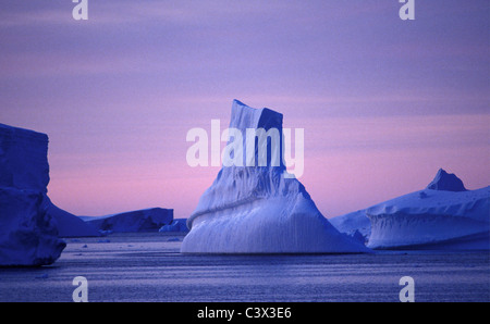 Antarctica. Landscape. Floating iceberg at sunrise. - Stock Photo