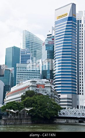 The Fullerton Hotel and Singapore Skyline with Singapore River and Marina Bay Waterfront Republic of Singapore Asia - Stock Photo