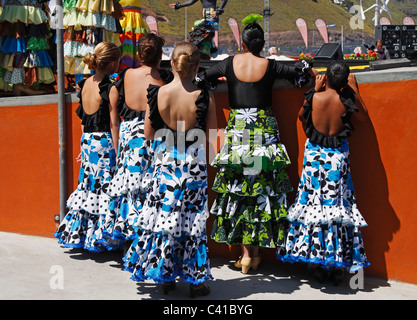 Young Flamenco dancers watching dancer from backstage at Feria de Abril. Spain - Stock Photo
