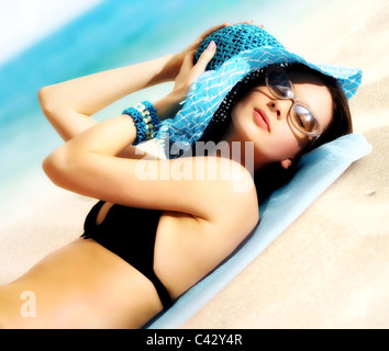 Portrait of a young girl lying in the sun - Stock Photo