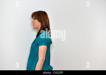 Portrait of serious young woman - Stock Photo