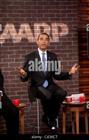 President Barack Obama participates in an AARP tele-town hall on health care on Tuesday, July 28, 2009. - Stock Photo