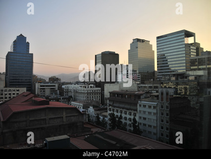 Sunrise view of buildings, apartment blocks glass skyscrapers, looking north from a Hotel Galerias room, Centro, - Stock Photo