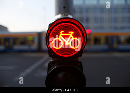 Bicycle traffic light in downtown Leipzig Saxony Eastern Germany - Stock Photo