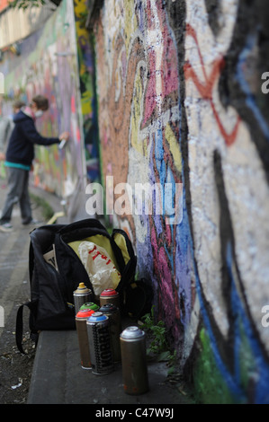 Boy trying out street art or graffiti in The Tunnel, Waterloo. - Stock Photo