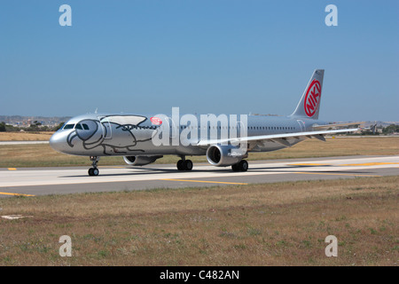 Commercial air travel. Niki Airbus A321 taxiing for departure from Malta - Stock Photo