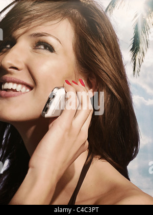 Woman talking on cell phone at beach - Stock Photo