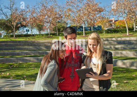 California Multi ethnic racial Ethnically diverse group teenagers Blackfoot American Indian, Hispanic teens using - Stock Photo