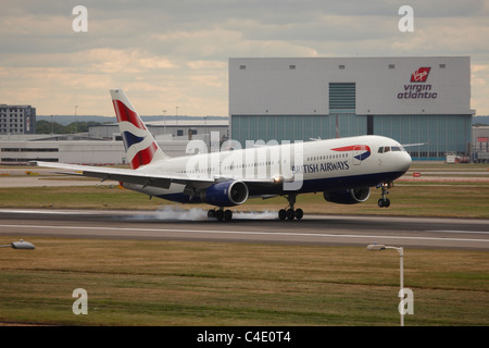 British Airways boeing 777 Aeroplane at London Heathrow Airport - Stock Photo