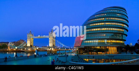 Europe, United Kingdom, England, London, Tower Bridge and City Hall at Night - Stock Photo