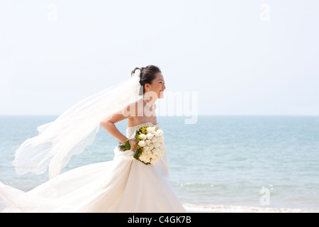 Happy Bride Running on the Beach - Stock Photo