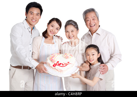 Happy Family Holding a Cake - Stockfoto