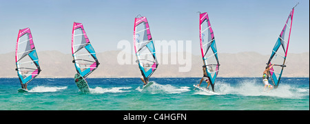 A sequential 5 image view showing the movement of a windsurfer performing tricks on the red sea at the resort of - Stock Photo