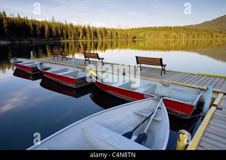 Row boats at dawn on Pyramid Lake, Jasper National Park, Alberta, Canada. - Stock Photo