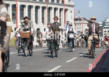 Well-dressed cyclists ride in the London Tweed Run, 2011 - Stock Photo