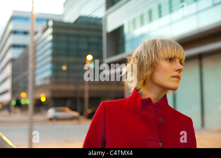 Young woman looking with anticipation, portrait - Stock Photo